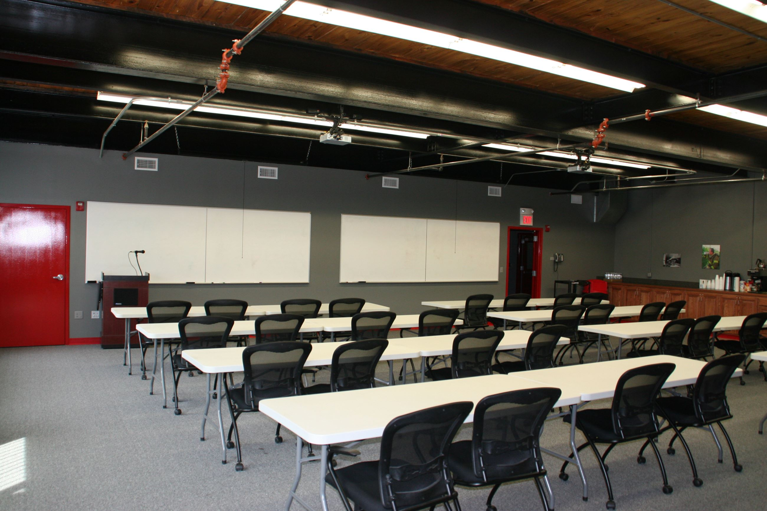 Paola Fire Department Large Training Room with tables and chairs set up.